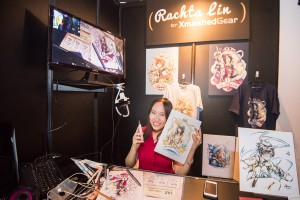 Rachta Lin live drawing at Xmashed Gear's booth